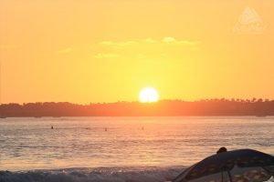 Sunset at the beach and umbrella
