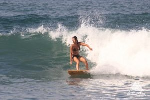 Woman surfing waves in the Pacific